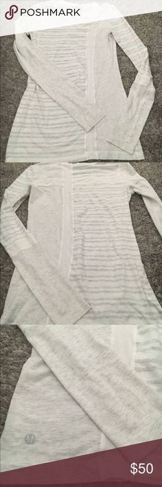 Lululemon striped long sleeve shirt Gray and white striped Lululemon long sleeve t-shirt. Soft cozy material- great for throwing on after a workout. Two small stains on one sleeve (see picture) but otherwise great condition. Size 4. lululemon athletica Tops Tees - Long Sleeve