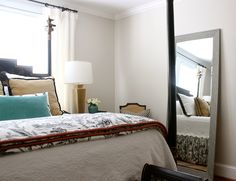 This large mirror from HomeGoods helped open up this small bedroom.  #sponsored #HappyByDesign #HomeGoods