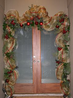 "Front Door Garland using 21"" Deco Mesh and wired ribbon and tucking in some fresh greenery"