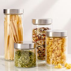 Features:  -Set includes 4 canisters.  -Material: Glass with metal lids.  -Easy screw-on lids.  -Exclusively ours.  Function: -Non-decorative.  Product Type: -Canister.  Primary Material: -Glass.  Num