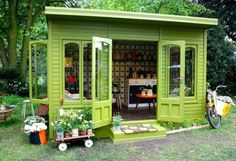 ADORABLE garden shed. There is a cute little sitting room inside complete with seating and a fire place. So cute.