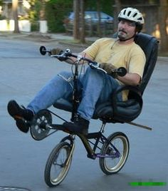 Small bike upgraded to a recumbent bike with an office chair.