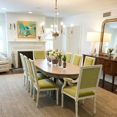 Stephanie Johns Design - Pindler chartreuse velvet white framed Louis chairs around an antique wood table, abstract art, mahogany buffet, gilt mirror, neutral rug
