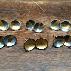 Ana González - Colombia. Earrings, Black patina on silver 925 and gold details | Aretes, Patina negra sobre plata 925 con detalles en oro.