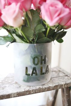 Get glass vase, letter stickers, glass frosting spray paint and masking tape.