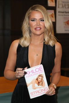 Khloe Kardashian Photos - Khloe Kardashian Book Signing For 'Strong Looks Better Naked' - Zimbio