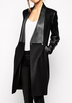 Equally classy and warm for harsh Winter nights. This black PU leather sleeve coat features longline silhouette with long PU leather sleeves, PU detailing in front with front button and two side pockets. | Lookbook Store