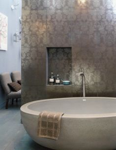Large tub against a silver damask wall