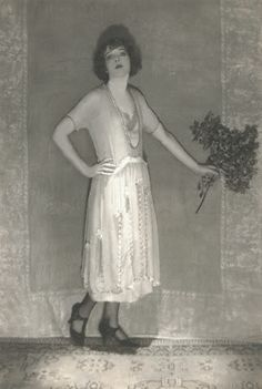 c.1921 Baron de Meyer ,Actress Ina Claire   Actress Ina Claire wearing an embroidered dress in gray chiffon and charmeuse, by Bendel, worn in the play 'The Gold Diggers'