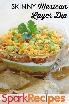 Layered Mexican dip with baked lime chips--just like you would buy at the store, but made so much healthier and lightened up!