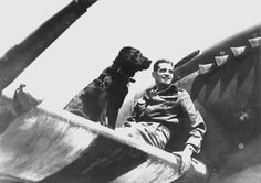 James Edgar Johnson (flying ace with 38 confirmed enemy aircraft destroyed) with his Labrador dog, Sally, on the wing of his Spitfire in Normandy, c. June–August 1944.