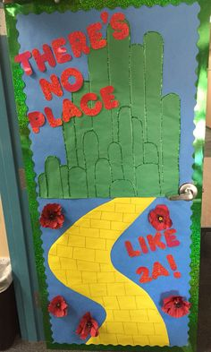 """Here's my Wizard of Oz themed door. I saw the """"There's no place like second grade"""" pin and decided to change it just a bit. (But that door is COMPLETELY FAB.) The only thing that's not on here yet are my kiddos' names (they go in the bricks). Oh! And the poppies are attached with Velcro, so when they get knocked off I just stick them back on."""