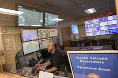 Remote sensing geophysicist Dave Schneider monitors volcano, weather and air traffic data from the Alaska Volcano Observatory operations room. Scientists at AVO monitor dozens of volcanoes in Alaska and work with the Federal Aviation Administration, National Weather Service and other agencies to issue alerts when hazardous activity is identified. (Loren Holmes / Alaska Dispatch News)