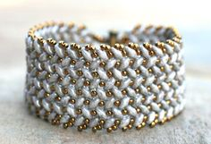This is a great bracelet that will go with both silver and gold jewelry. Silver gray super duo beads are woven in to this Herringbone pattern. Vintage