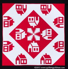 Village Square by Megan Manwaring.  2nd prize, Red and White: predominantly hand quilted. 2015 Quilters' Guild NSW show (Sydney, Australia).