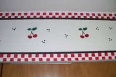 Here's the stenciling I did on the sofit in my kitchen, with stencils I made myself, to match the rest of my red, white and black cherry kitchen.