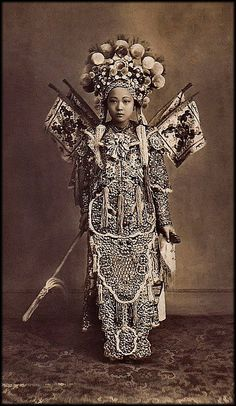 This stunning beauty's portrait was taken in Cholon, a part of Chochinchina, and now known as the southern part of Vietnam. In the late 1800s, it was under French control. The beauty of the girl's face is matched only by the incredible richness of her dress. She was in fact an actress with a Chinese theatre troupe.