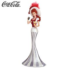 """""""Coney Island Style"""" COCA-COLA Victorian Lady Figurine. Limited-edition COCA-COLA® lady in Victorian attire holding a vintage-style glass of COKE®. Accented with real feathers and glitter."""