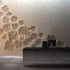 Lobby Reception Rear Wall - Shan Shui with leave carving to represent Great Wall og China with new identity wall texture