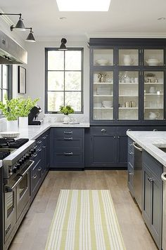 gray cabinets, marble countertop, tall cabinets with glass, windows, lighting, etc for-the-home