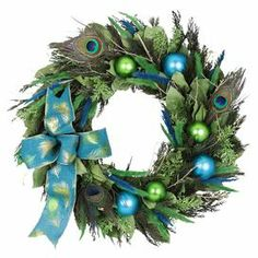 """Preserved green cedar wreath with green and turquoise fox tail. Features a peacock ribbon and natural twig base.   Product: WreathConstruction Material: Leaves, cedar, fox tail, twigs, sage, and ribbonColor: MultiDimensions: 18"""" DiameterCleaning and Care: Wipe gently with a dry cloth"""