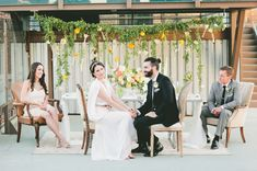 Love how relaxed the Bride and Groom and bridal party look in Archive Rentals chairs in this beautiful spring urban rooftop wedding!