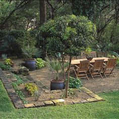 create a low-maintenance patio area with borders and pea gravel. this would be a really nice solution in our side yard.