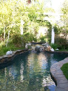 """Swimming pool that blends naturally and seamlessly. Seems to have """"sprung"""" up naturally from the rocks."""