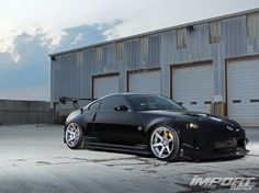 """Larry Kenney's 2003 Nissan 350Z track edition has been built around the idea of """"functional+"""" design. From the C-West aero, to the CJ Motorsports intake plenum, to the INGS+1 E-type hood, to the twin-turbo VQ35DE, everything on this Z33 has been calculated with pinpoint precision. - Import Tuner Magazine"""