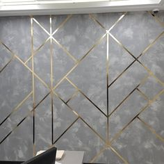 Smooth Concrete texture wall with Golden geometrical lines looks stunning. Gorgeous new look for financial office Wall Texture Design, Concrete Wall Texture, Wall Panel Design, Wall Decor Design, Ceiling Design, Smooth Concrete, Living Room Wall Designs, Accent Walls In Living Room, Home Room Design