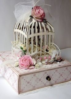 Lovely - no instructions but I think it is just 4 x Tim Holtz Caged Bird die cuts put together to creat a 3D effect cage.