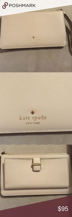 NWOT Kate Spade wallet wristlet This never used, authentic Kate Spade wallet or wristlet (can be used as either), is gorgeous! It has plenty of room for all your cards, ID, etc. with a zippered pocket to put things in, plus a button that opens on the back to add all your card and Easily show your ID. kate spade Bags Wallets