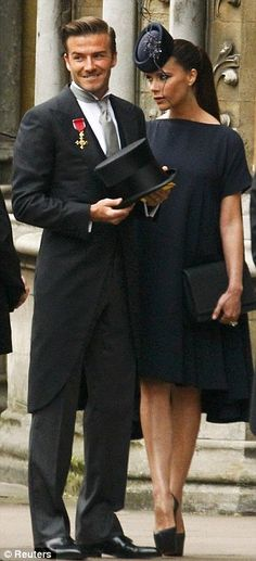 Stylish: Victoria and David Beckham arrive for the Royal Wedding today. Victoria wore a dress of her own design while David looked sharp in a Ralph Lauren suit