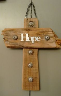 Wooden cross i made for my cousin from pallets slats with an industrial touch.