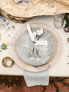 neutral place setting - photo by Lauren Fair Photography http://ruffledblog.com/bohemian-wildflower-wedding-inspiration