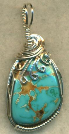 A Frog And Bear Creations Original! One of a kind handcrafted by me! Freeform USA Turquoise gemstone cab wrapped in sterling silver wire. Pendant measures 1 1/2 x 3/4 inch. Thanks for browsing my item ! See My Shipping Policy for Combined shipping