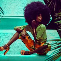 Ooooooh! Now THIS is how I imagine Emmy Hughes in the book, The Last King, to be. Tall, dark-skinned (she's probably darker in the book), elegant, and all that hair. Granted, this model probably has more hair then I imagine Emmy to have, but you get the point. Love it.