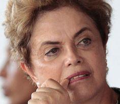Esta é a figura de uma louca , assassina e ladra.Dilma , vai pra cuba que te pariu.