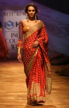 Ritu Kumar Couture. Love the pretty red and gold bridal saree or sari with blouse.