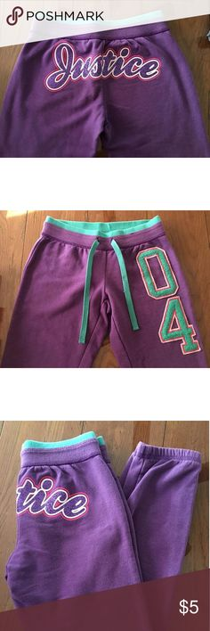Justice Sweat Pants Purple sweat pants with glitter JUSTICE written on the back.  Good condition. Justice Dresses