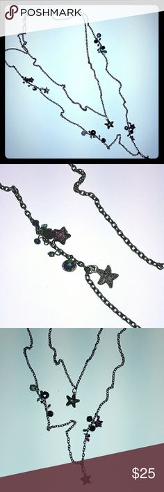 "Headed star fish 2 layer chain necklace Handmade antique silver tone 2 layer necklace. Center star fish features a teal rhinestone. Lots of beads in purples and blues. Very pretty, hangs nice. Could also be worn with one strand hanging down your back with an open back top. Length is 14"" on shortest chain almost 20"" on longest chain. Lobster clasp closure Handmade Jewelry Necklaces"
