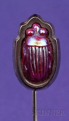 Sterling Silver and Enamel Scarab Stickpin, Tiffany & Co., c. 1910, set with an iridescent red scarab, 5/8 in., signed.