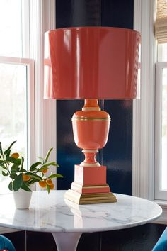 A high-gloss Mary McDonald lamp tops an Eero Sarinaan tulip table in the family room.