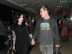 "Reality personality Kat Von D, 33, and ""Jackass"" star Steve-O, 41, looked completely smitten as they strolled through LAX hand-in-hand this week."