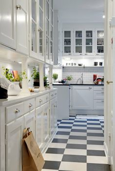 via Content in a Cottage  . Starting with the checkered floor and working my up the white cabinets to the great drawer pulls to the white subway tiles to the old-fashioned upper cabinets -- I love it all!
