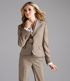 The business core wardrobe must contain two suits with three pieces each:  a jacket, a skirt and pants.  One suit should be of a basic color such as gray, black or navy.  The other suit could be a bright color such as red or even pink.  Add a great white blouse and a couple of basic but colorful, coordinating tees, and mix and match these basics to make multiple outfits.