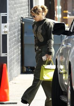 Jennifer Lopez in a green ensemble | For more style inspiration visit 40plusstyle.com