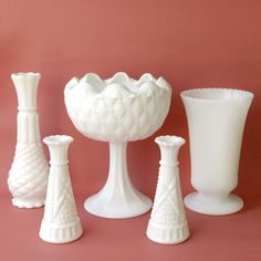 Real or fake, milk glass collections look lovely displayed in front of a shot of colour.