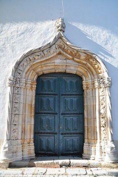 ^Beautiful stone surround blue door.