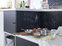 A matt black UDDEVALLA cover panel doubles as a chalkboard. You can write on it - everything from recipes and to-do lists to the children's many activities. Ikea, Chalkboard, Kitchen Island, Home Decor, Creative Ideas, Activities, Children, Recipes, Black